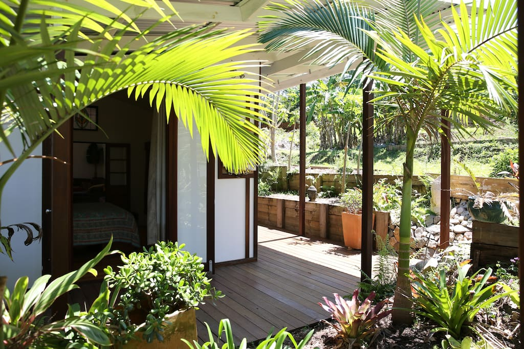 Tropical Gardens surround the decks around the house
