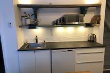 Custom county kitchen with tin backsplash