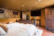 Safari room with plush King Bed, TV, surround sound and spectacular views