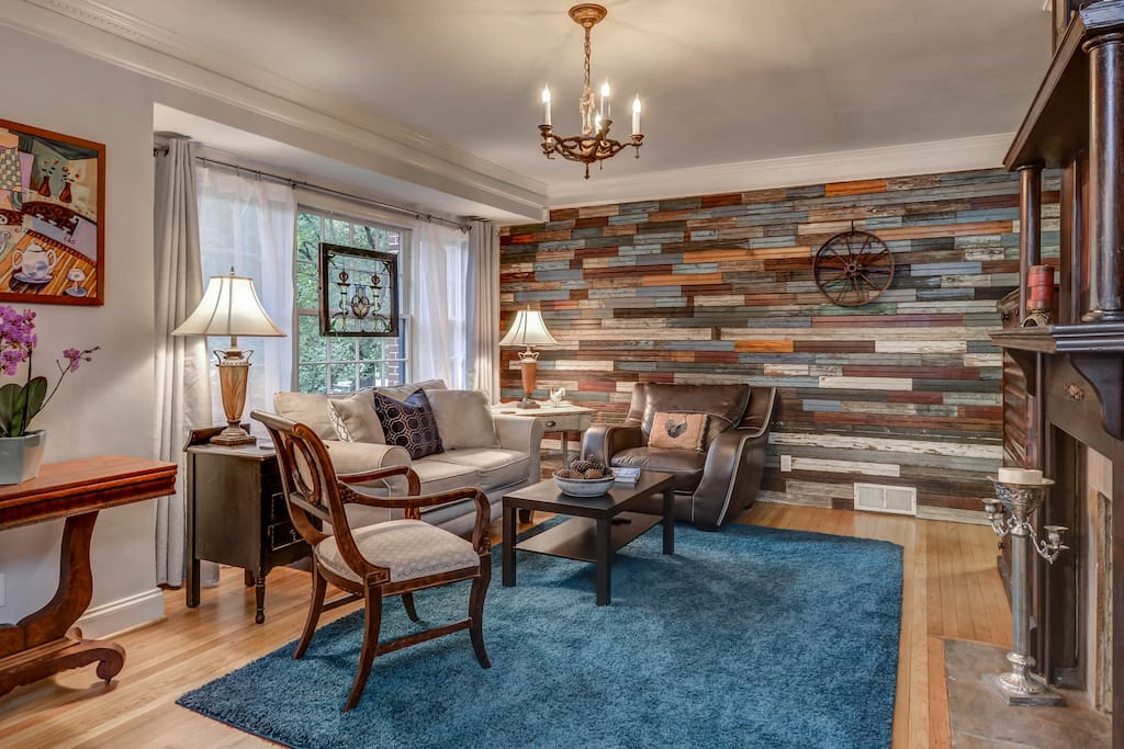 Our spacious designer renovated  living room features a wall of 120 year old beaded board, an antique mahogany victorian mantel, original white oak floors, stained glass, and comfortable furniture.  Our large flat screen tv has roku, both packages for loads of entertainment.