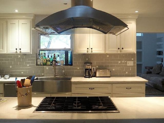Our brand new kitchen with extremely high-end top-of-the-line appliances.  Well equipped for whatever you want to create!
