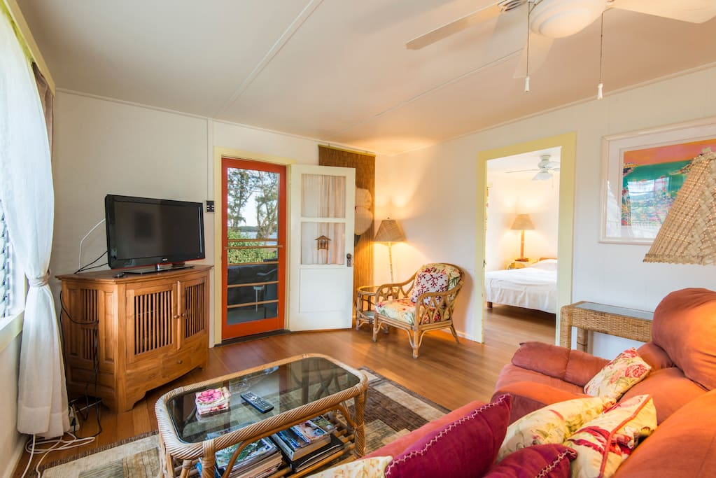 Enjoy a DVD or book while lounging in the comfy plantation style living room.