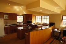 Large kitchen for self catering or socialising while your host prepares your meals