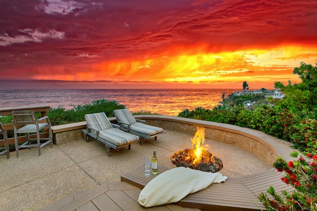 Stunning views from your private outdoor living space with fire pit and lounging chairs
