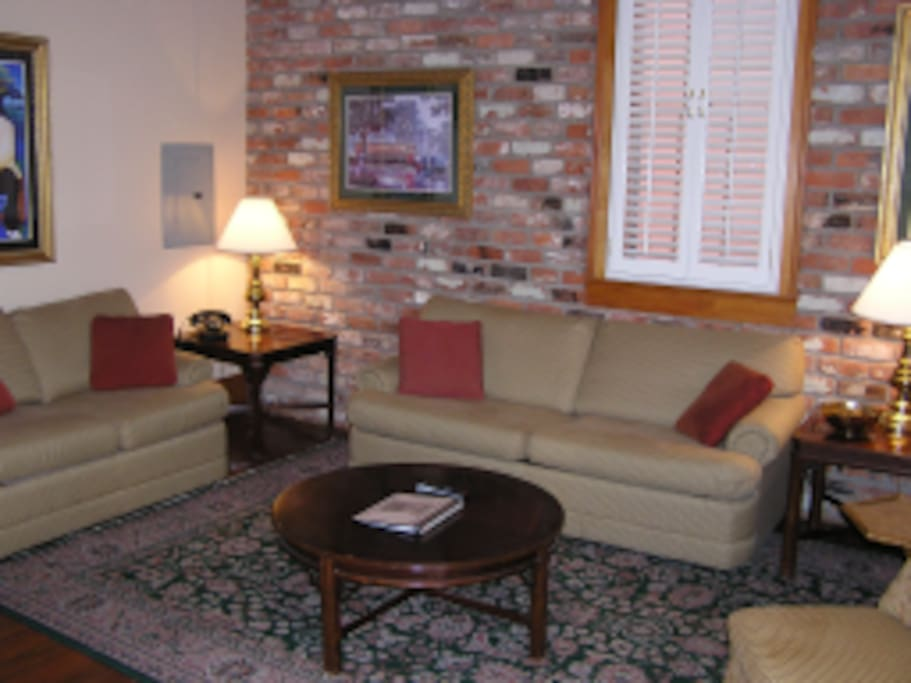 Picture of living room in a large renovated suite. Our suite is similar but not quite as large.