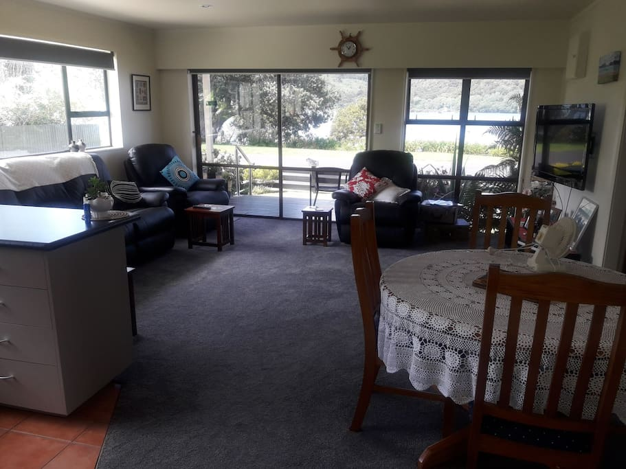 lounge , dining area looking out onto Whitianga estuary.