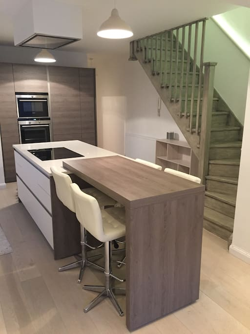 Modern open plan kitchen and hand painted staircase