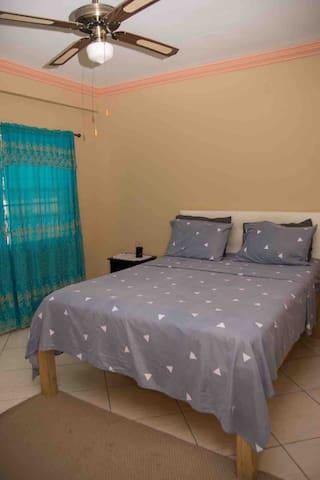 First floor bedroom with queen size bed.