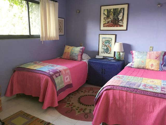3rd floor bedroom with twin beds and private bath