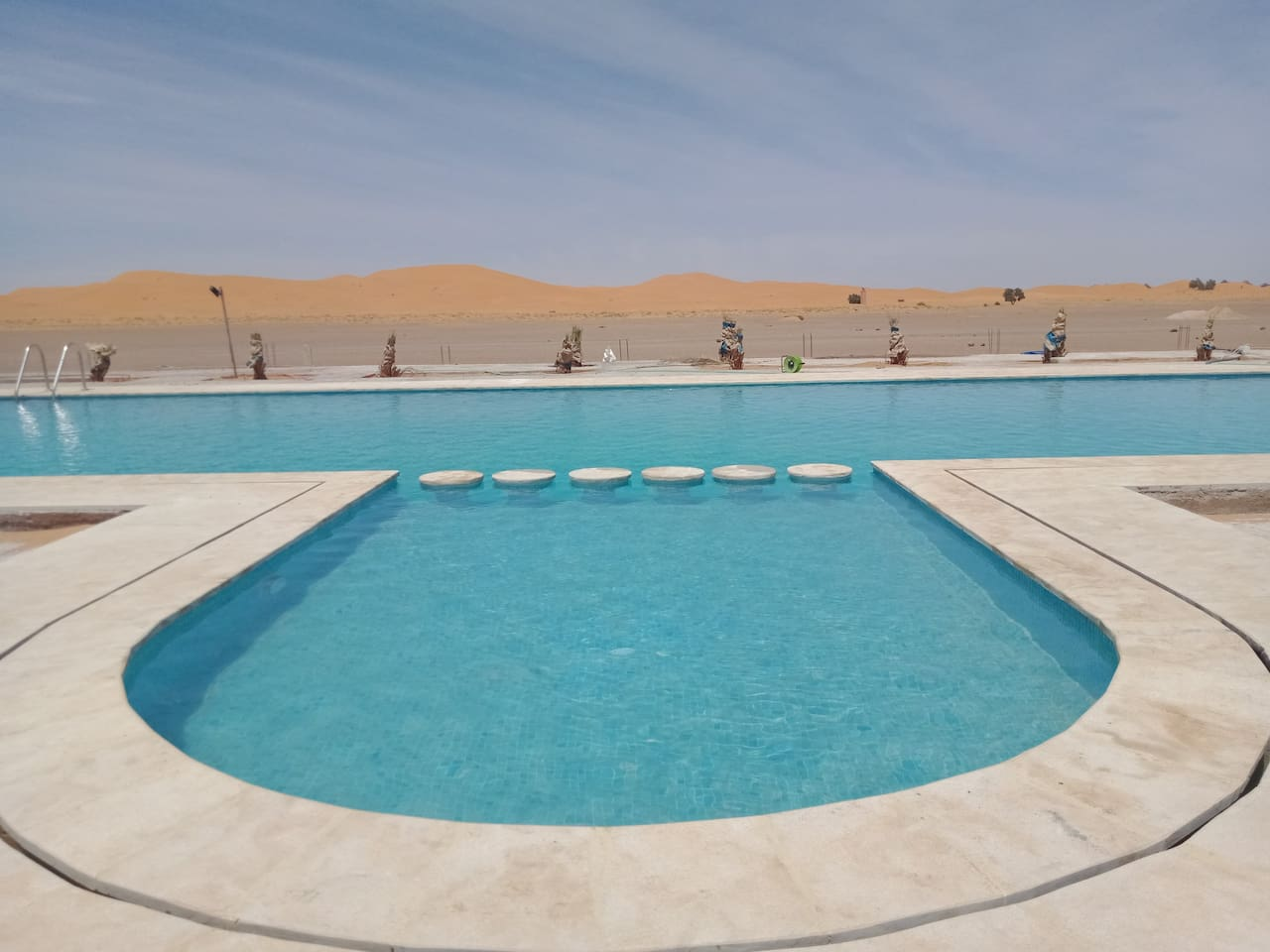 Our Castel is just in front of the Sahara dunes and in a few meters from the asphalt road.
