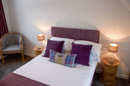 Fully relax in our Highland Cow luxury room, enjoying room service, watching SKY tv