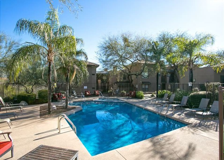 The pool is located steps away from the condo.