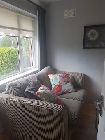 Cosy couch in bedroom