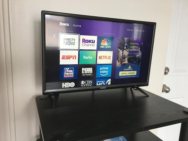 TV operates with a ROKU. Bring your passwords to stream your personal content.