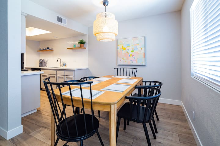 Large dining table begs to have a family gathering or a friendly game of cards.
