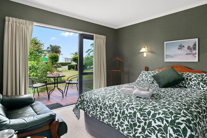 """Bedroom 3: Mount View Room The Green Room is spacious and just off the lounge, it features mount views, all day sun, French doors to outdoor garden area, with outdoor bistro setting on the deck perfect for morning tea. """"Must stay for a good experience with family who have got kids and wanting peace of mind.""""- Tshering, Oct 2020"""