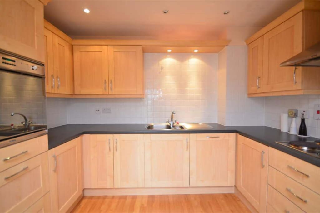 Fitted chrome Kitchen with Oven and microwave plus  dishwasher & washing machine/dryer