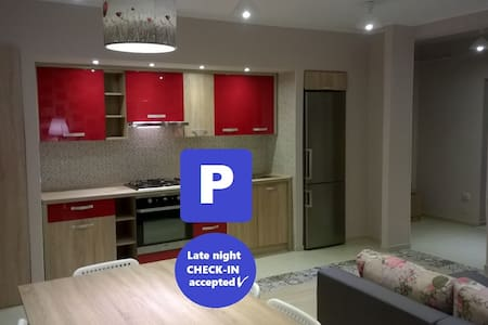 Red modern apartment with free private parking