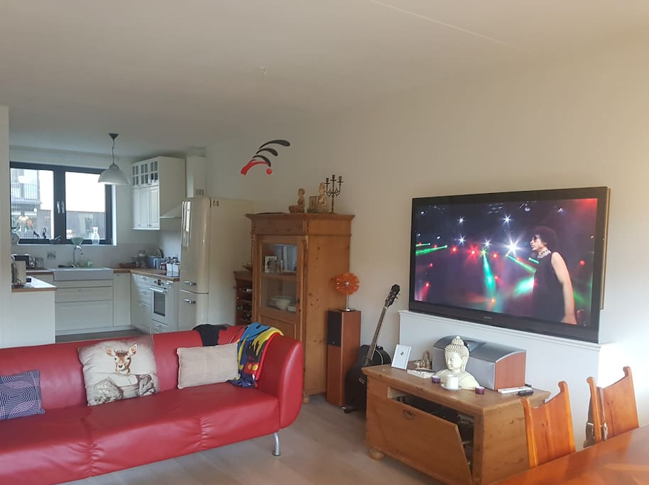 the living room with the tv elevated