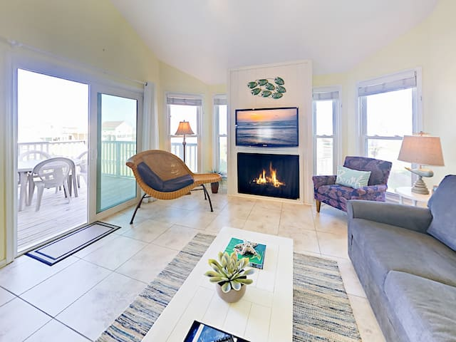 The living room features direct access to the deck.