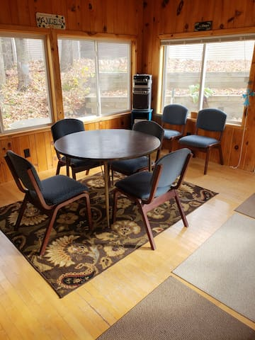 Sun room with space to change out of outdoor equipment.