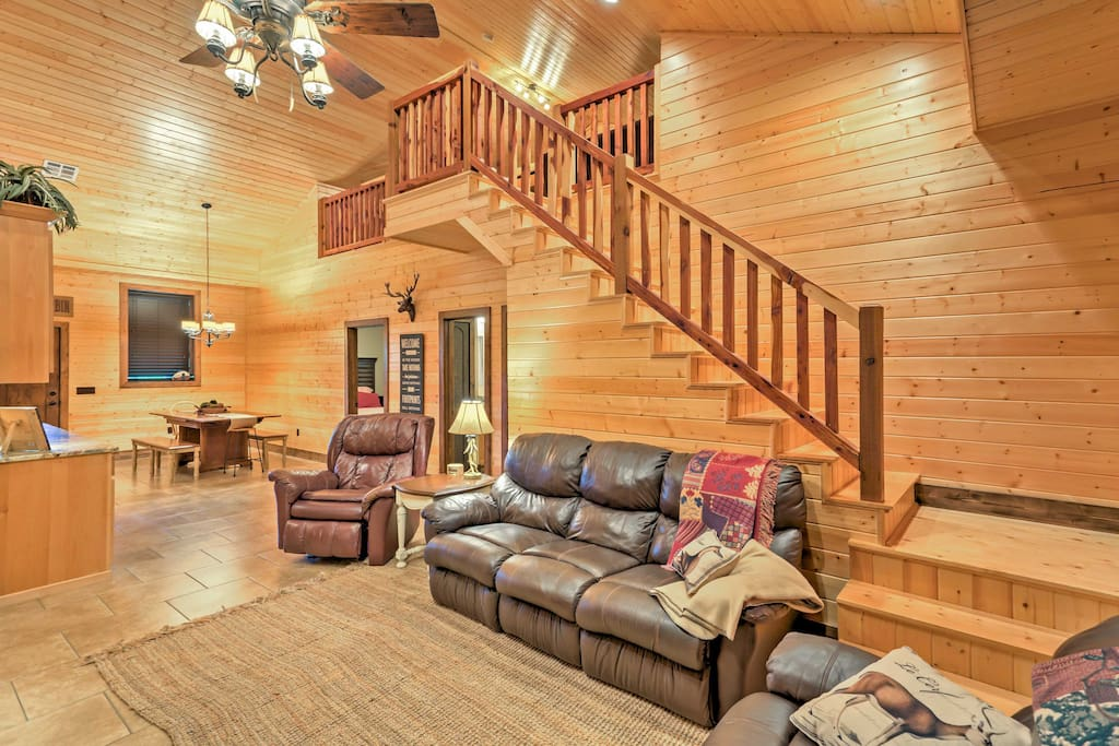 As you step inside this rustic mountain home, you'll be surrounded by wood paneling, vaulted ceilings, and comfortable furnishings.