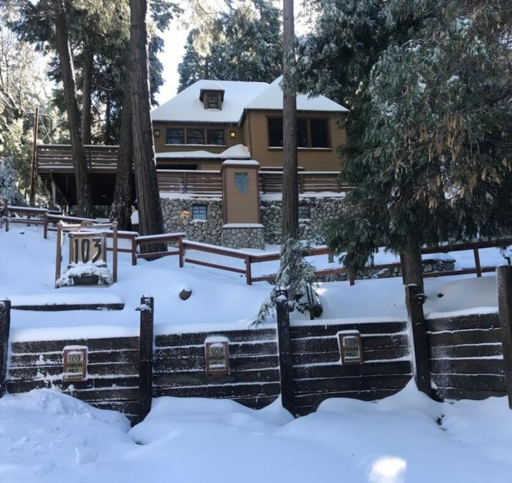 Winter snow-covered view of Bunkhouse from the parking area