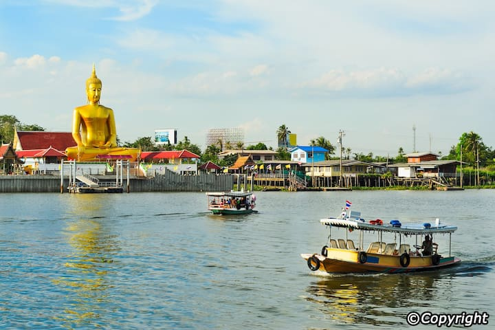 Koh Kret Island: Take a cab/Taxi to Wat Sanam Neua Temple (Approx. 120 baht), and then take a ferry across the river (5 THB) to Koh Kret island.