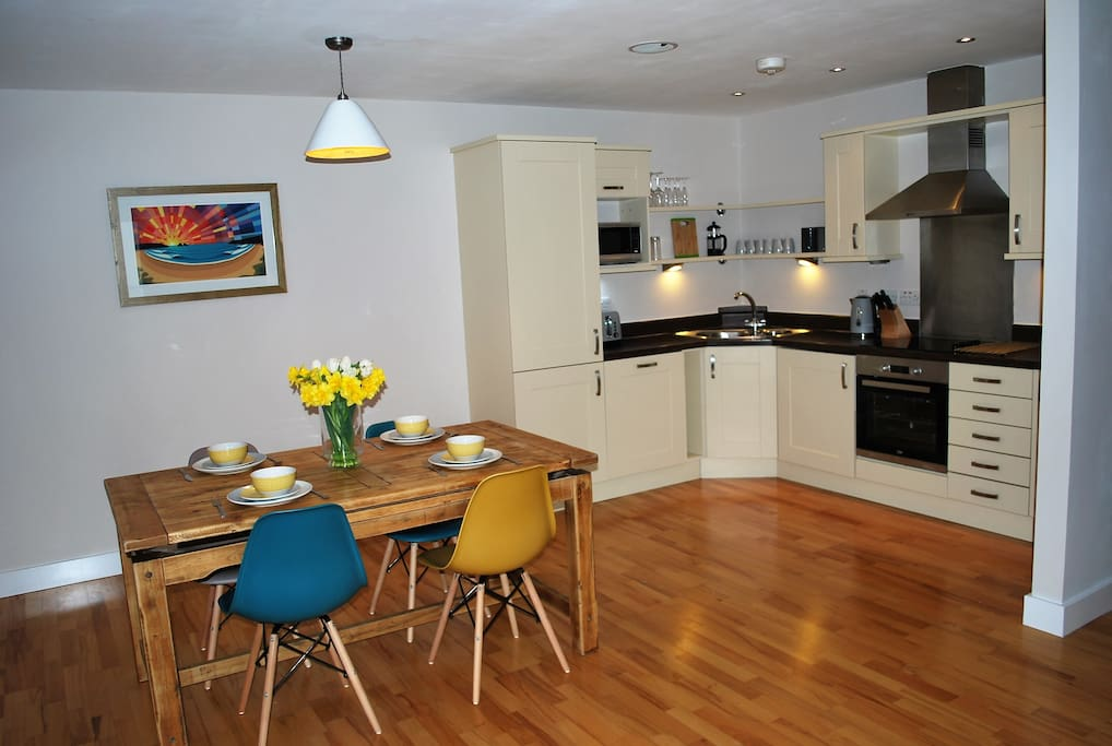 Open plan kitchen diner with oak table.