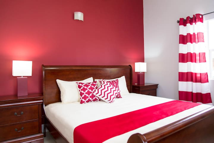 The Master Bedroom provides a color contrast to the rest of the villa