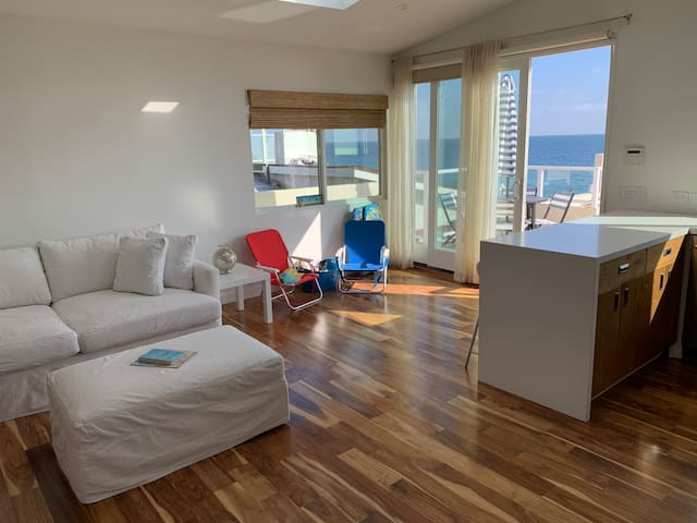 Bright open concept kitchen/living room with spectacular ocean views!