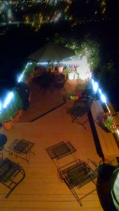 Our deck, usually available at night, is lovely.  Note the fountain and the rope lights. Enjoy!