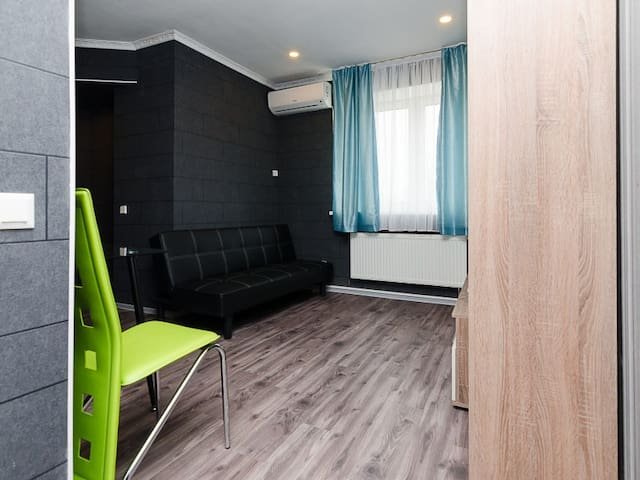 Two rooms with 1 bed and a sofa. Privat Hotel