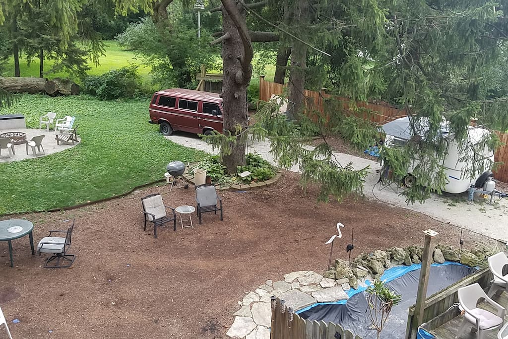 Enjoy the quiet splendor of our lush backyard from multiple vantage points--the deck, the pond w/waterfall, or one of three fire pits. Relax in the hammock or swing.
