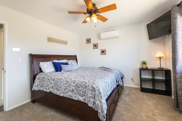 This bedroom has a very large California King bed and a TV with Netflix.
