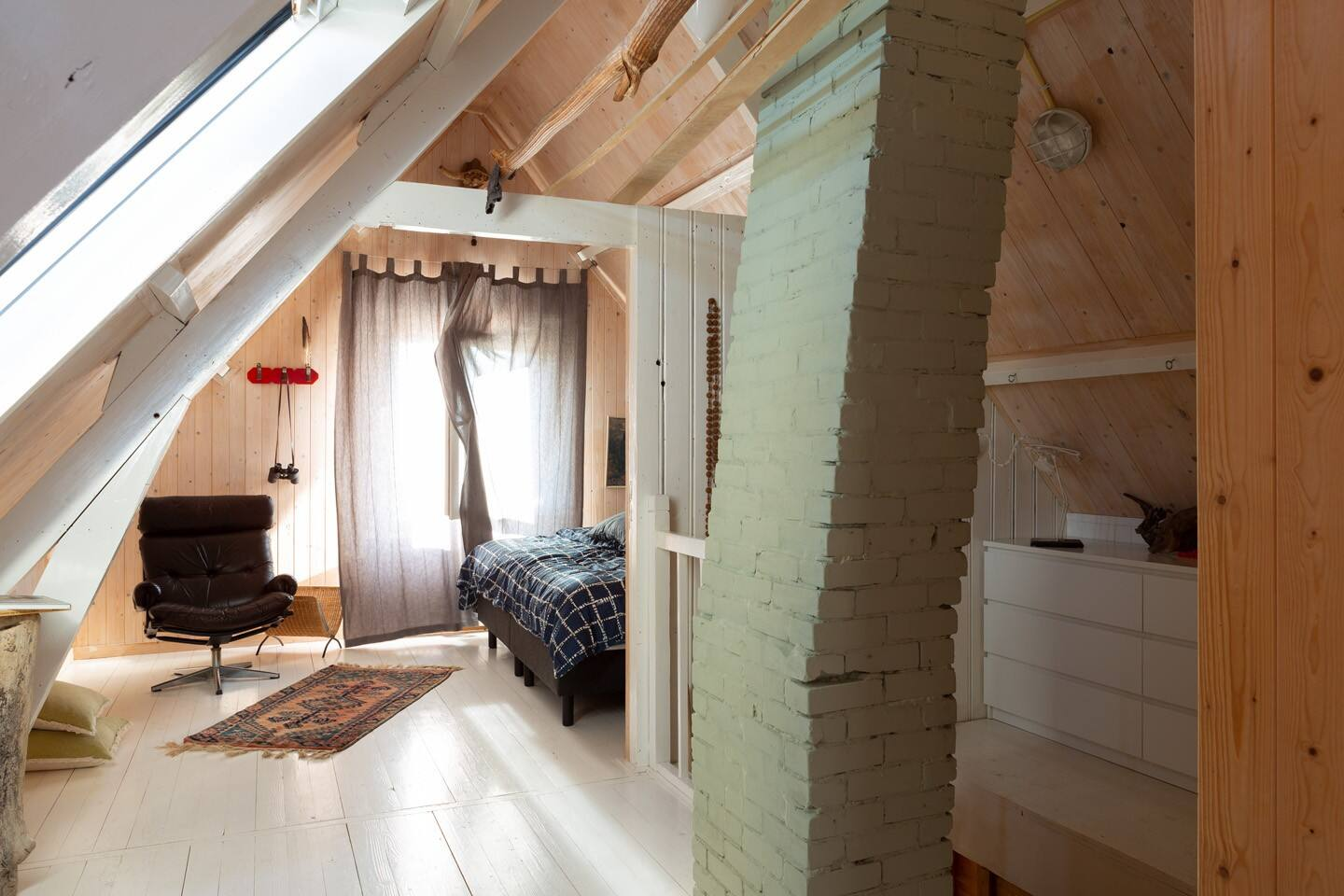 Welcome to our super cosy attic room! Lovingly refurbished into a small apartment with a bed, seating area and open bathroom.
