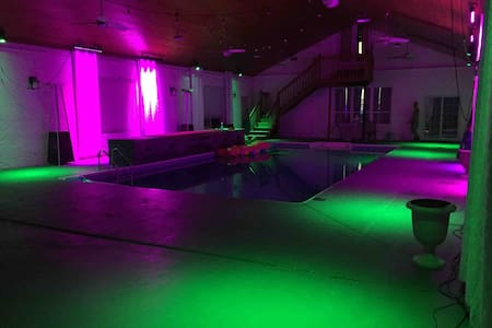 Private indoor pool with club lighting