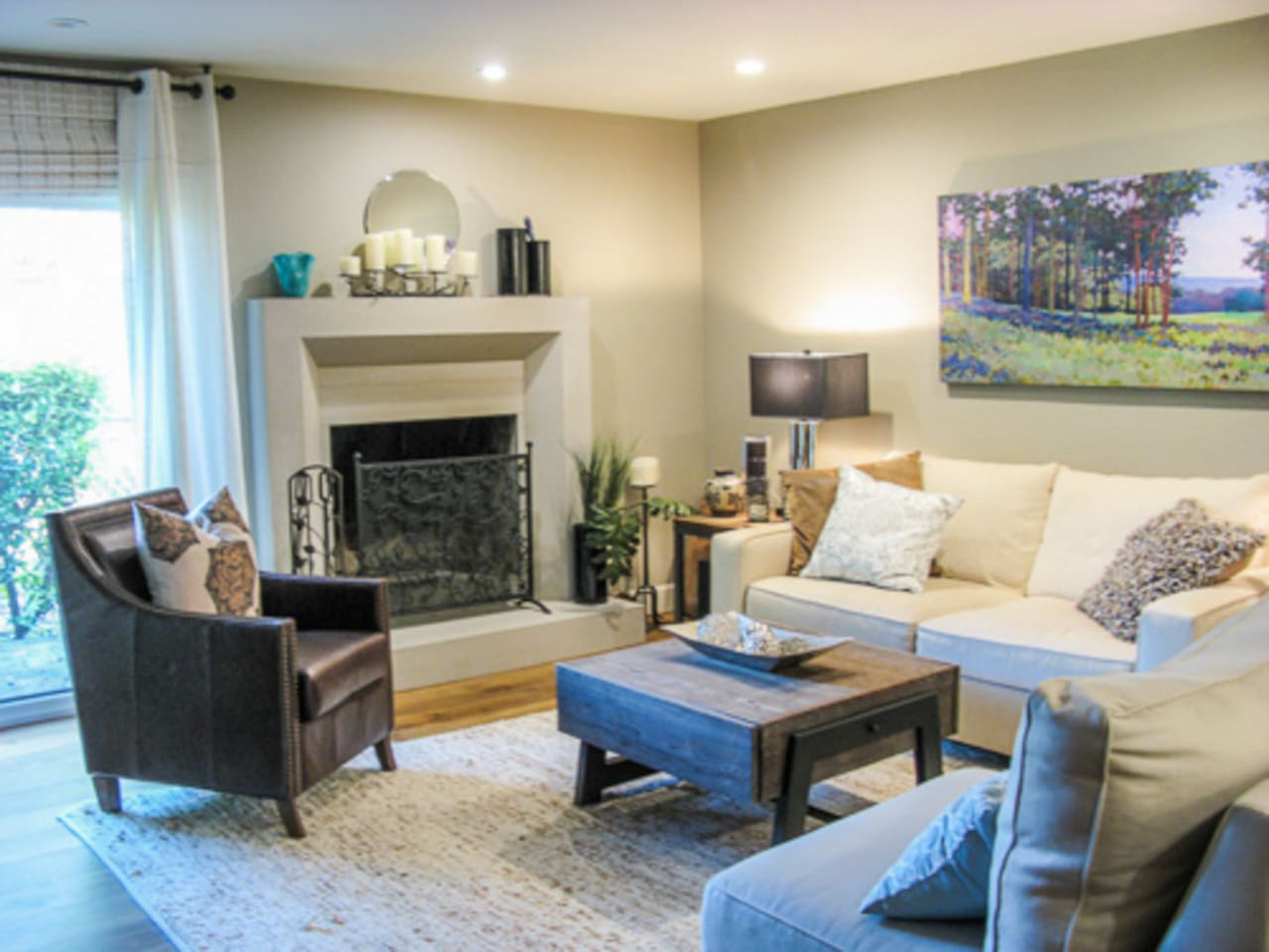 Living space with gas fireplace opens to back patio