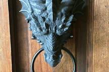 On the front door of Dragon Manor.