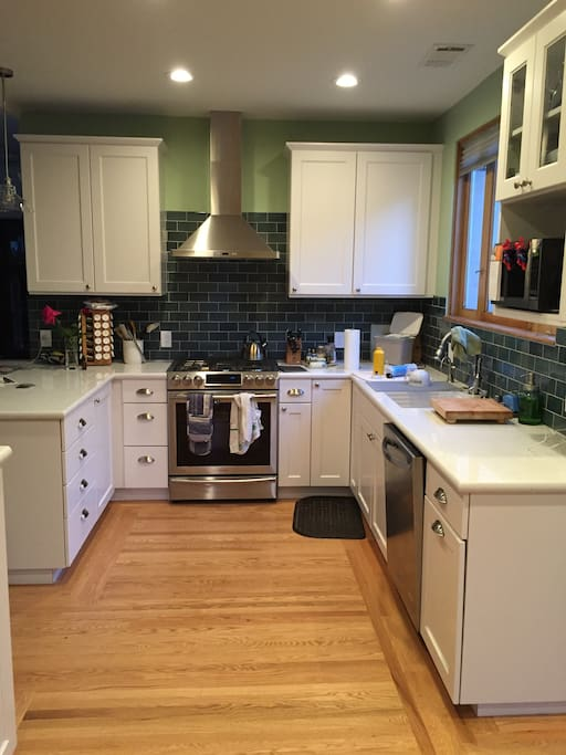 Remodeled kitchen features updated cabinets and appliances.