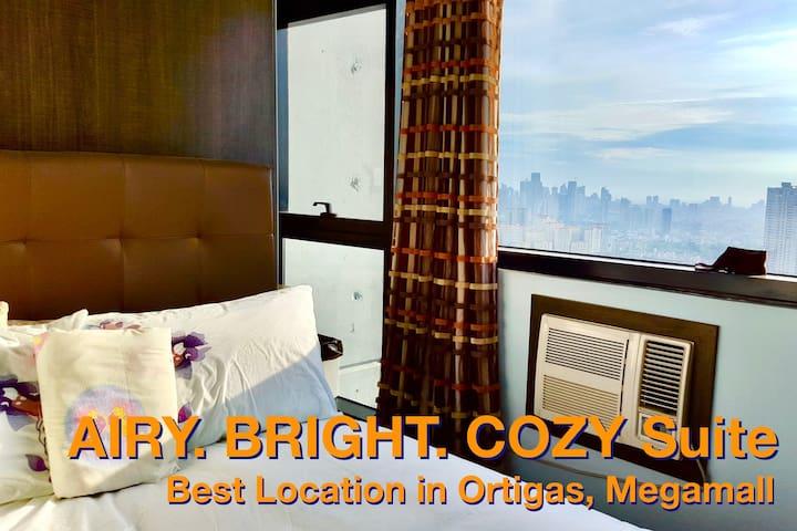 AIRY. BRIGHT. COZY Suite - Best Location Ortigas