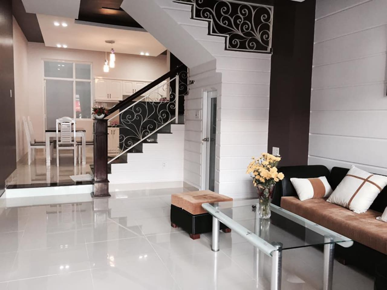 Spacious living room, stairway, and kitchen