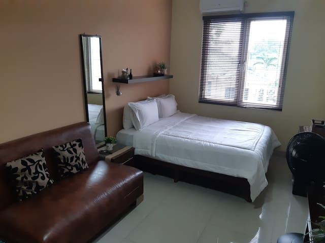 This private bedroom is equipped with sofa, AC and TV