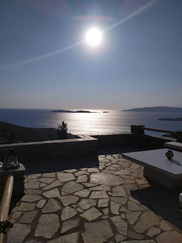 Spectacular sunset in a confortable cycladic house