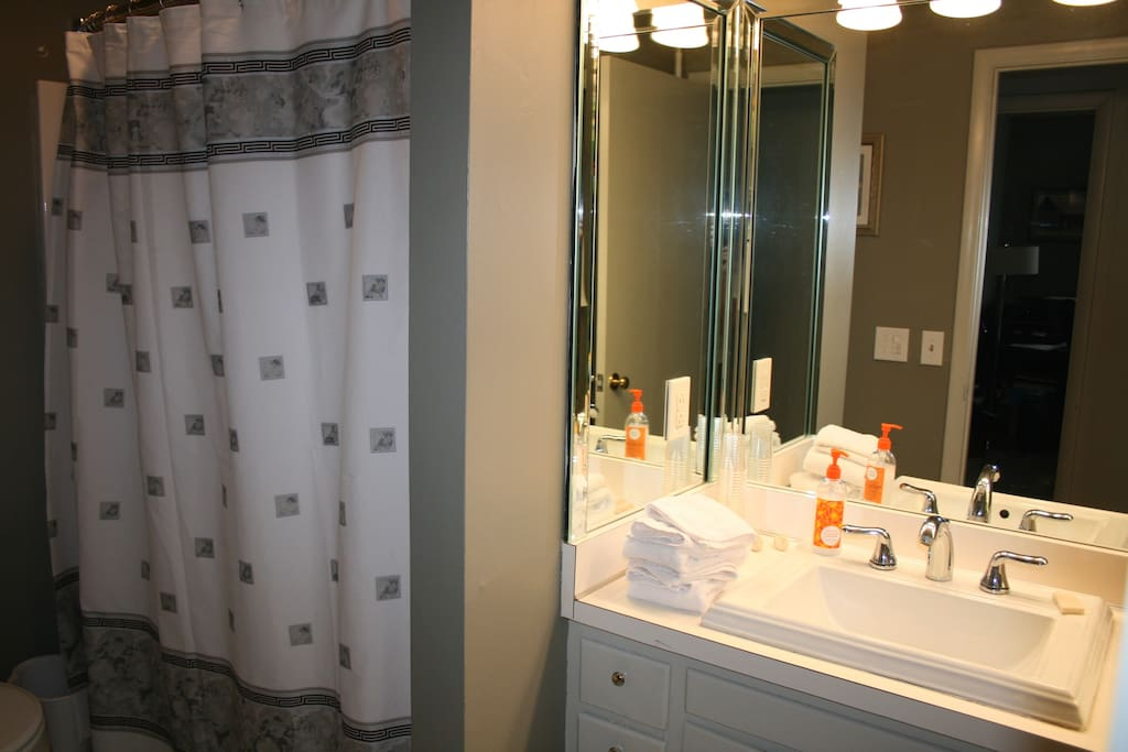 Full private bath with wonderful, three sides with mirrors in vanity area.