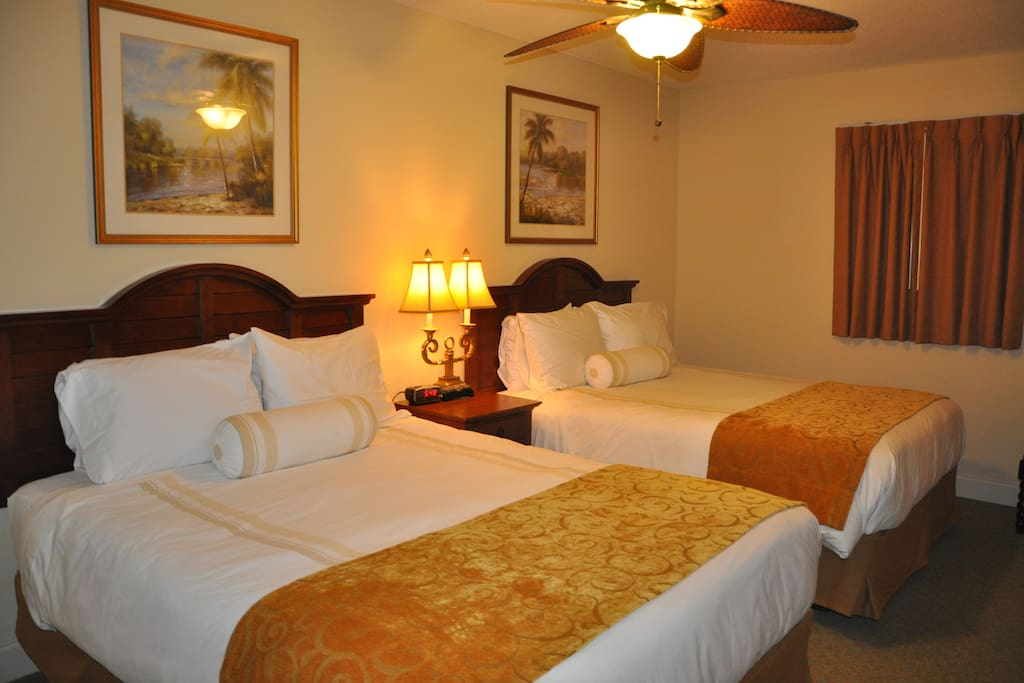 The roomy Master suite with 2 queen beds made with luxury bamboo linens