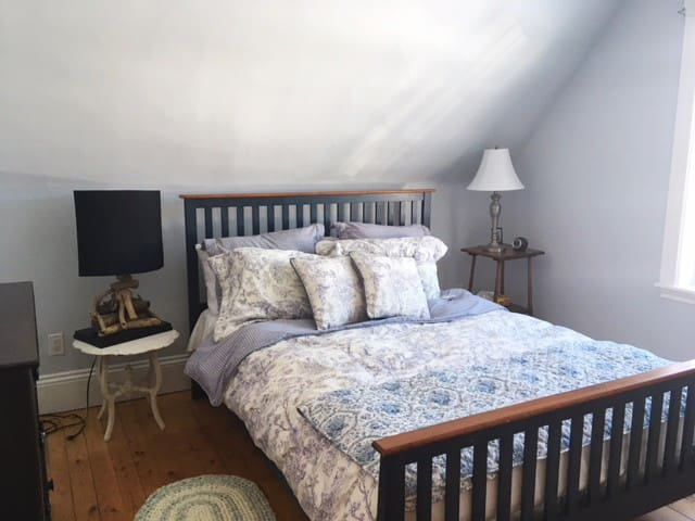 Also on the second floor, you have another lovely bedroom with a Queen bed.  The original 1843 architecture can be seen in the sloped roofline.