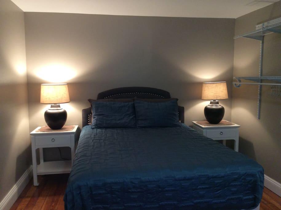 Bedroom with queen sized mattress.