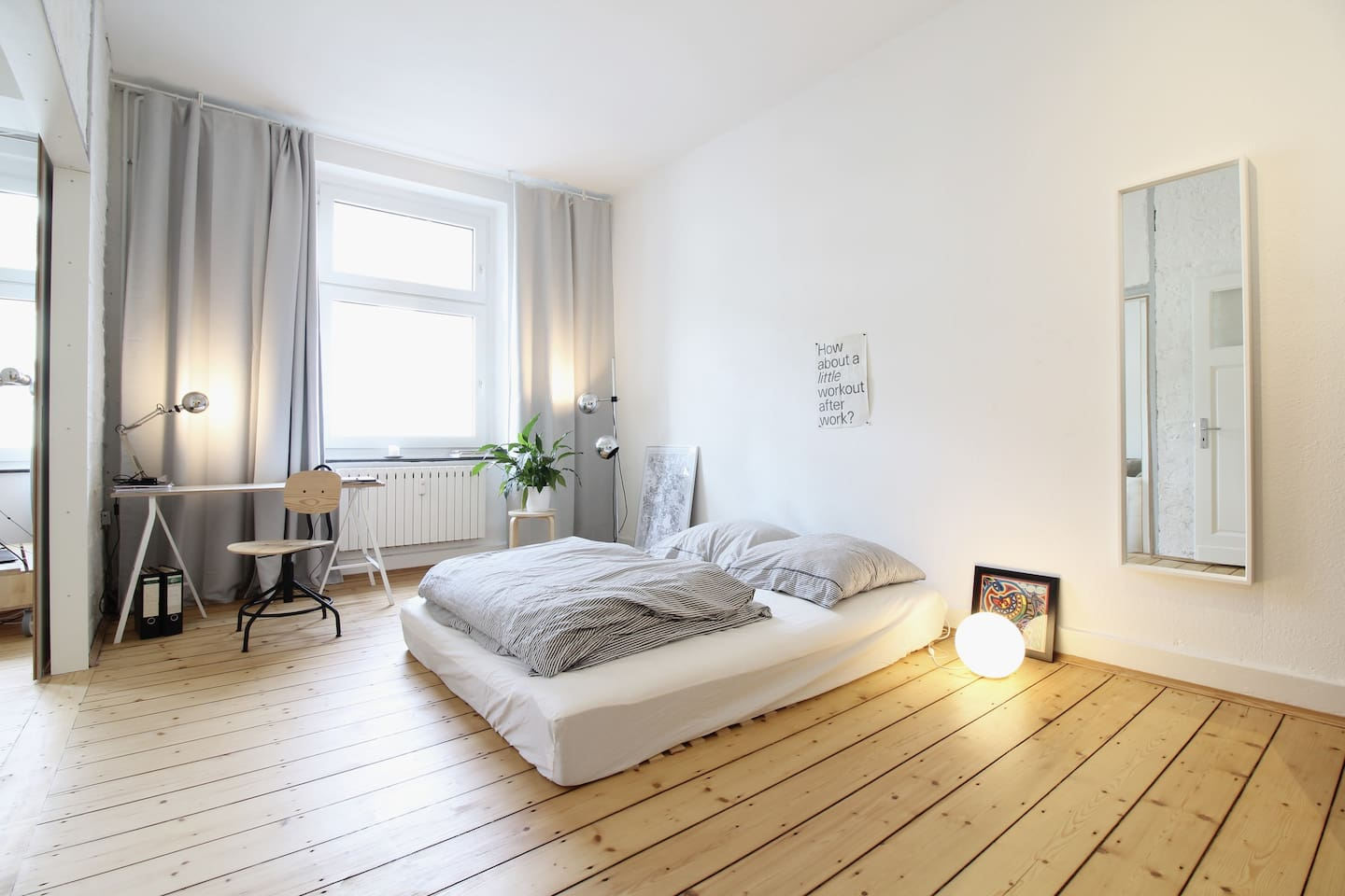 The bedroom with a minimalistic design promises restful nights after a long busy day.