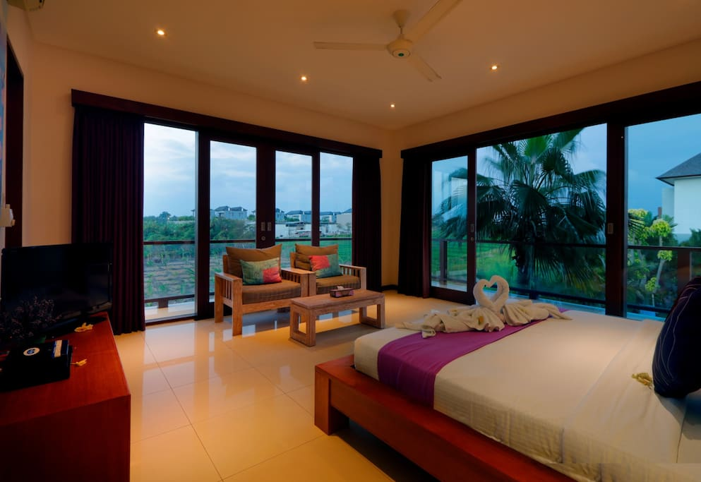 Bedroom with large windows and abundance of natural light